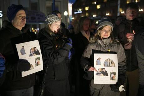 Others at the vigil in Boston on Saturday held signs with photos of Eric.